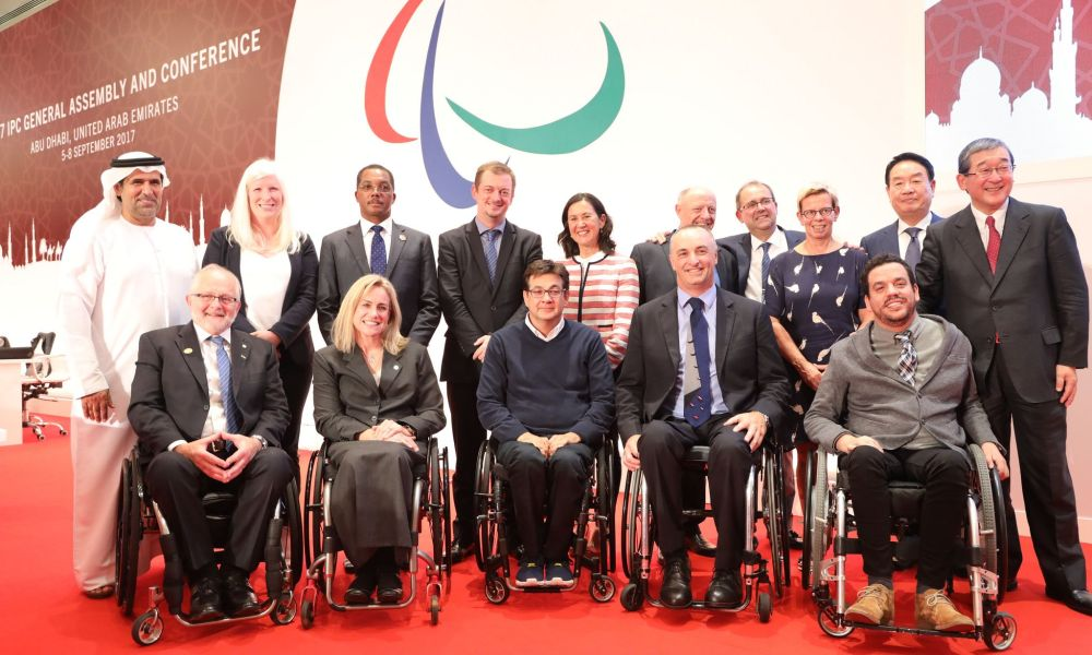 Photo (credit: IPC): New IPC president Andrew Parsons (in the back, fourth from left) – former President Sir Philip Craven (front row, left)