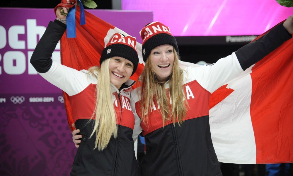 Photo (Charlie Booker): Heather Moyse (right) with pilot Kaillie Humphries after winning Olympic gold in Sochi 2014