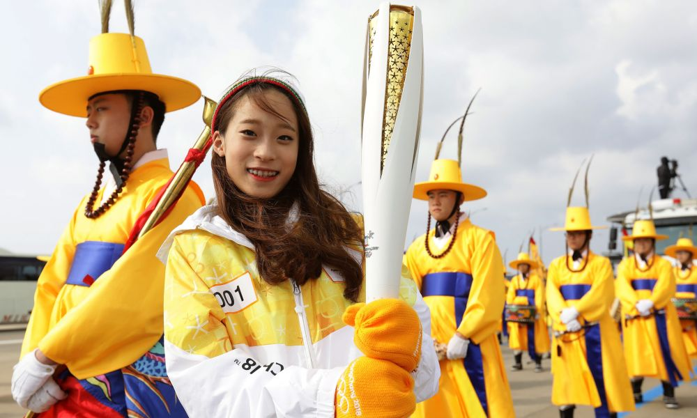 Photo (IOC Media) - INCHEON, SOUTH KOREA - NOVEMBER 01: First torch bearer South Korean figure skater You Young hold the PyeongChang 2018 Winter Olympics torch during a torch relay on November 1, 2017 in Incheon, South Korea. (Photo by Chung Sung-Jun/Getty Images)
