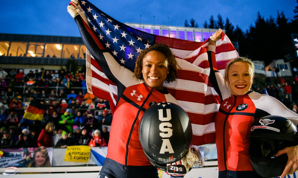 Lauren Gibbs (left) and pilot Kaillie Humphries (USA) celebrating after their gold medal run at BMW IBSF World Championships 2020; Photo: IBSF / Viesturs Lacis